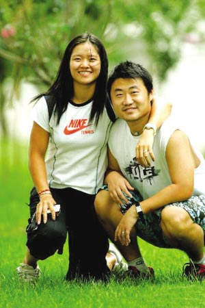 Li Na with her husband and coach, Jiang Shan [xinhuanet.com]