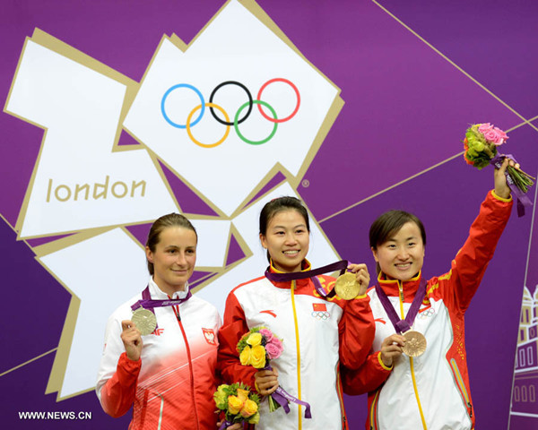 Gold medalist Yi Siling of China (C), silver medalist Sylwia Bogacka of Poland (L) and bronze medalist Yu Dan of China celebrate during the victory ceremony of the Women's 10m Air Rifle competition of the London 2012 Olympic Games in London, Britain, on July 28, 2012. [Xinhua]