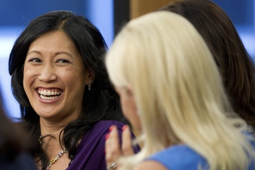 "Theresia Gouw Ranzetta, partner with Accel Partners, left, laughs during the taping of ""Women To Watch Round Table"" for Bloomberg Television in San Francisco on June 13, 2012.  [time.com]"