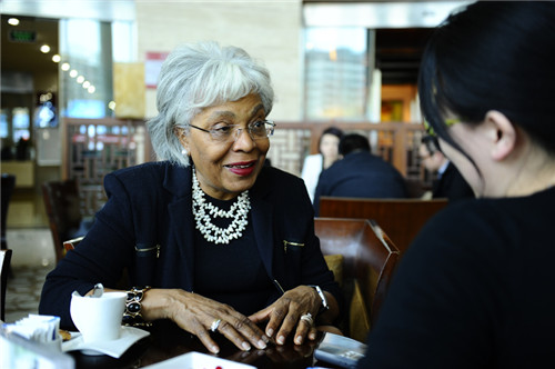 Journalist of Women of China interviews Esther Silver-Parker (L), President and CEO of the SilverParker Group.