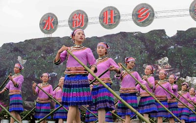"Women of Dai ethnic group perform during a folk custom and culture festival marking the ""San Yue San"" (the third day of the third lunar month in Chinese Calendar) in Shizong County, southwest China's Yunnan Province, April 12, 2013. The festival, attracting tens of thousands of local residents and tourists from both at home and abroad, was held here Friday. [Xinhua]"