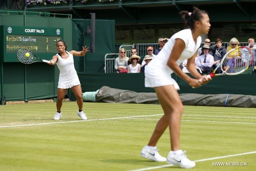 Megan Moulton-Levy (L) of the United States and Zhang Shuai of China compete during the first round of ladies' doubles against Mona Barthel of Germany and Liga Dekmeijere of Latvija on day 3 of the Wimbledon Lawn Tennis Championships at the All England Lawn Tennis and Croquet Club in London, Britain on June 26, 2013. Moulton-Levy and Zhang won 2-1. [Xinhua]