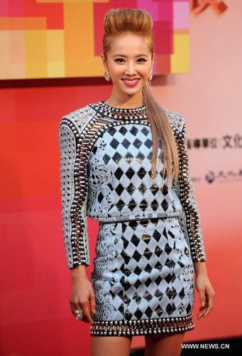Singer Jolin Tsai of Taiwan poses on the red carpet before the awarding ceremony of the 24th Golden Melody Awards at the Taipei Arena in Taipei, southeast China's Taiwan, July 6, 2013. [Xinhua/Tao Ming]