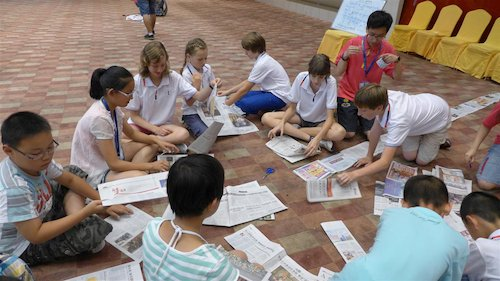 Children recycle old newspapers at the Bluestar International Summer Camp. [Women of China/Yao Yao]
