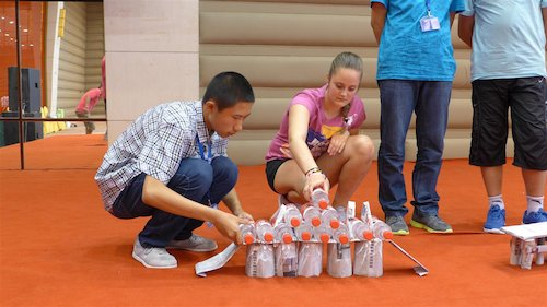 Children participate in a bridge building contest at the Bluestar International Summer Camp. [Women of China/Yao Yao]