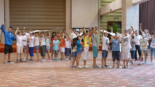 Children participate in a group activity at the Bluestar International Summer Camp. [Women of China/Yao Yao]
