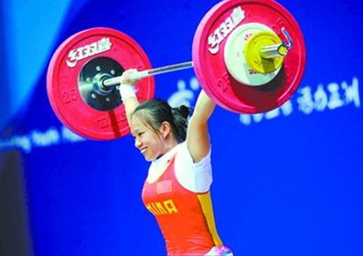 Chinese 15-year-old weightlifter Jiang Huihua takes the first gold in Asian Youth Games on August 17, 2013, by claiming the title of women's 48kg category with a total of 183kg. [chinadaily.com.cn]