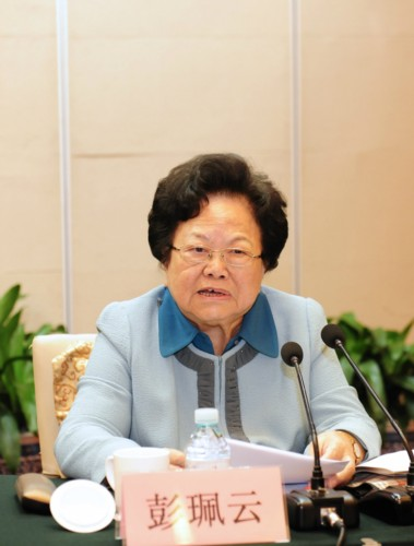Honorary President of the All-China Women's Federation (ACWF) and Honorary Director of the Chinese Women's Research Society (CWRS) Peng Peiyun gives a speech during a symposium held in Beijing on September 25, 2013, to discuss the newly published book Women's Theory and Practice of Socialism with Chinese Characteristics. [Women of China / Fan Wenjun]