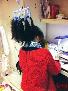 College Girl Hangs Hair Up to Stay Awake to Study