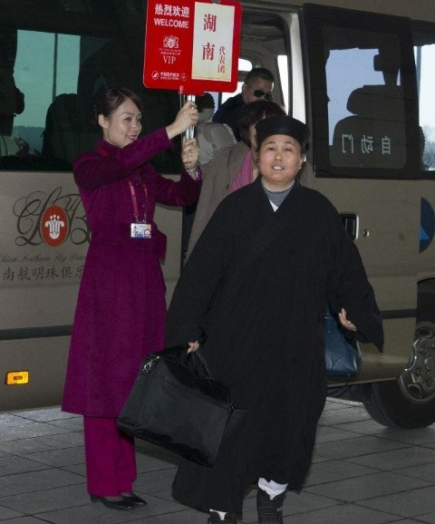 Members of 12th National Committee of CPPCC Arrive in Beijing