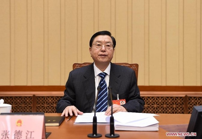 Zhang Dejiang, executive chairperson of the presidium of the second session of the 12th National People's Congress (NPC), presides over the third meeting of the presidium at the Great Hall of the People in Beijing, capital of China, March 12, 2014. [Xinhua/Li Xueren]