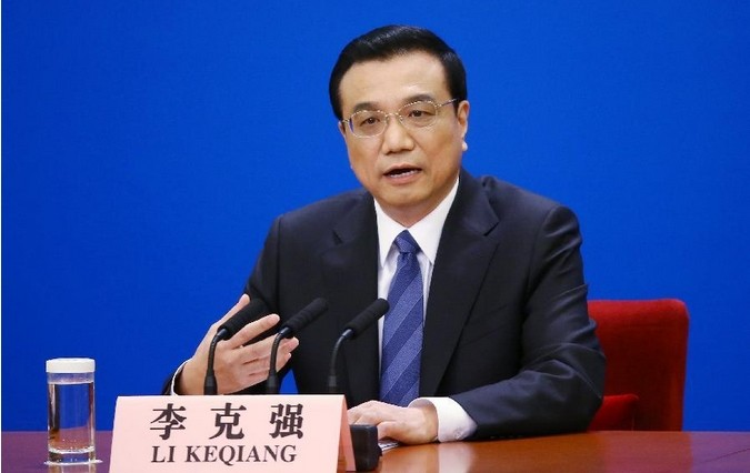 Chinese Premier Li Keqiang speaks at a press conference after the closing meeting of the second annual session of China's 12th National People's Congress (NPC) at the Great Hall of the People in Beijing, capital of China, March 13, 2014. [Xinhua/Chen Jianli]