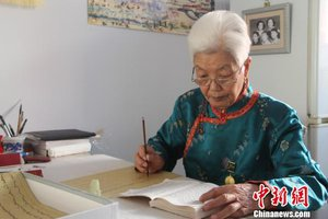 Mongolian Grandmother Transcribes Mongolian Epic with Ink Brushes