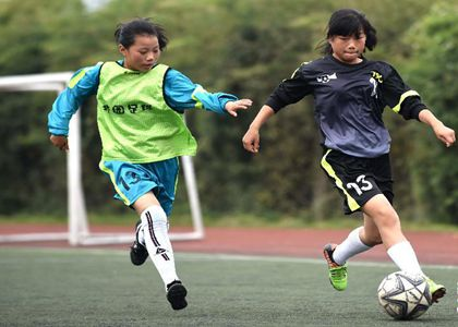 Teen Soccer Girls Shine on Schoolyard