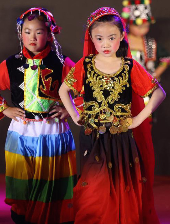 Pupils in Chinese ethnic costumes take to the catwalk presenting the hottest ethnic fashions at the Tenth Chinese Minority Culture Festival in Nanjing ...  sc 1 st  Womenofchina.cn & Pupils Show Ethnic Trend at Chinese Minority Culture Festival - All ...