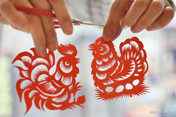 Chinese Folk Artist Makes Papercutting Works to Celebrate Spring Festival