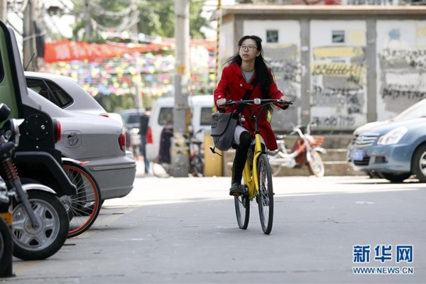 Young Woman Guards Shared Bike Scheme by Rewriting IDs