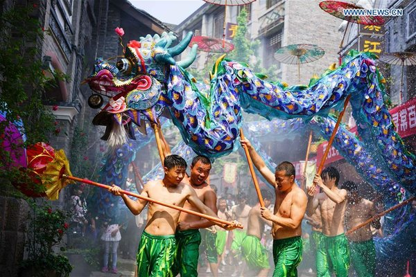 Dragon Dance Performed In Sw China During Int L Labor Day Holiday