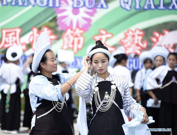 Bouyei Ethnic Group Hold Headscarves Contest in SW China
