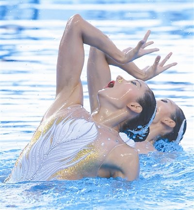 Synchronized Swimmer Pair Send Message of Success