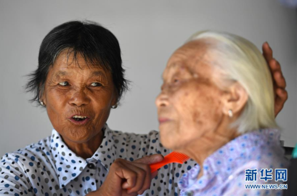 Woman Takes Good Care of Paralyzed Centenarian Mother-in-Law