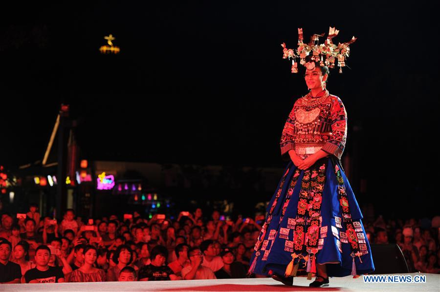 Models Present Traditional Costumes of Miao Ethnic Group in China's Guizhou