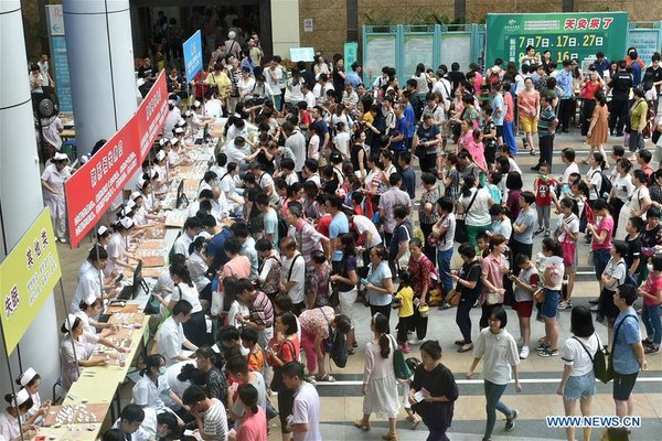 People Receive Sanfu Paste Treatment in Guangzhou, S China