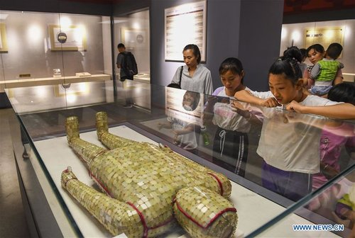 Artifacts of Western Han Dynasty on Display in Xinjiang Museum