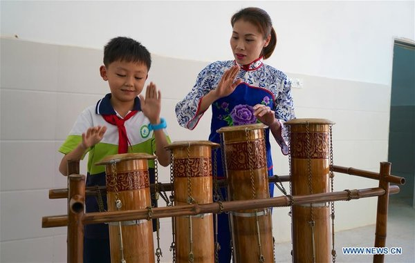 Members from Local Bamboo Music Band Give Lessons to Students in E China's Jiangxi