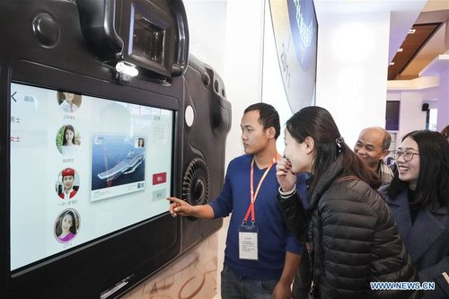 Visitors View Exhibition Commemorating China's Reform, Opening-up