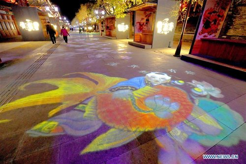 Pedestrian Mall Decorated with Lights Themed on Yangliuqing New Year Paintings in N China's Tianjin