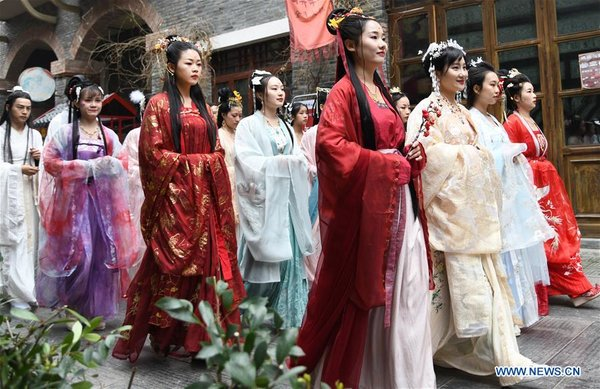 Women Wearing Traditional Costumes Take Part in Parade in Wuhan