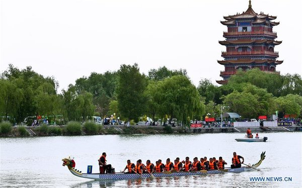 People Take Part in Dragon Boat Races to Celebrate Dragon Boat Festival across China