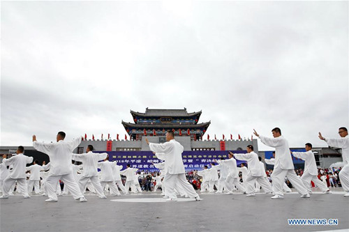 Taiji Fans Perform at Opening Ceremony of Tourism Festival in NW China