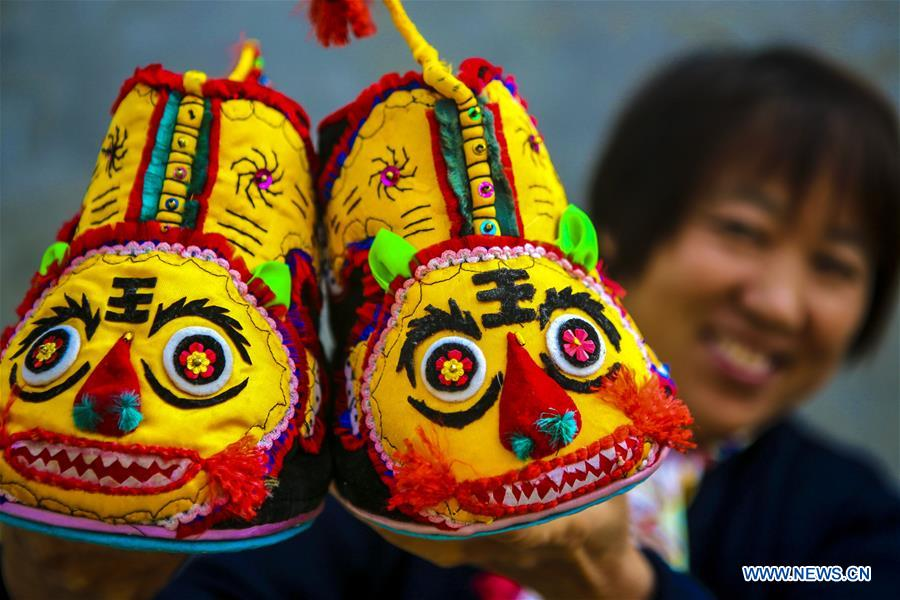 Tiger-head Shoes Making Helps Rural Women Increase Income in N China